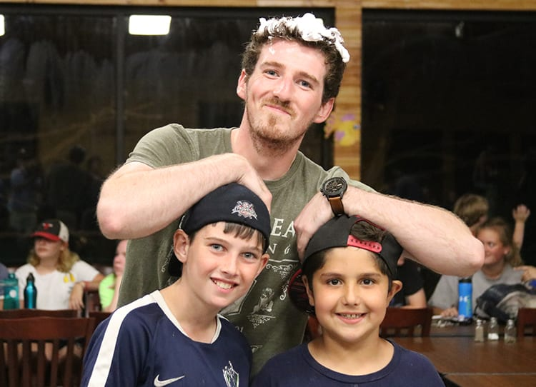 2019 Summer Team - Male counselor having fun with campers - Cub Creek Science and Animal Camp