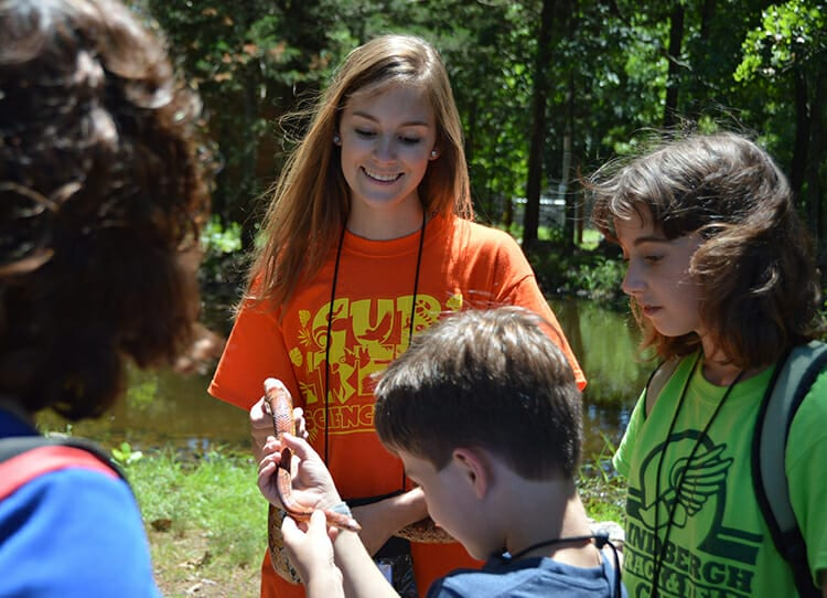 ASIT Program - ASIT showing snake to campers on check in day - Cub Creek Science and Animal Camp