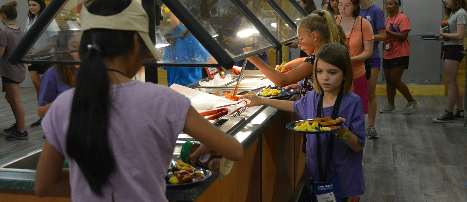 Camp Meals - Campers getting food at buffet bar - Cub Creek Science and Animal Camp