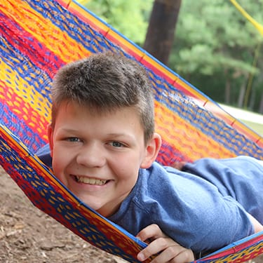 Camper Correspondence - Email a Camper - Happy Camper in hammocks - Cub Creek Science and Animal Camp