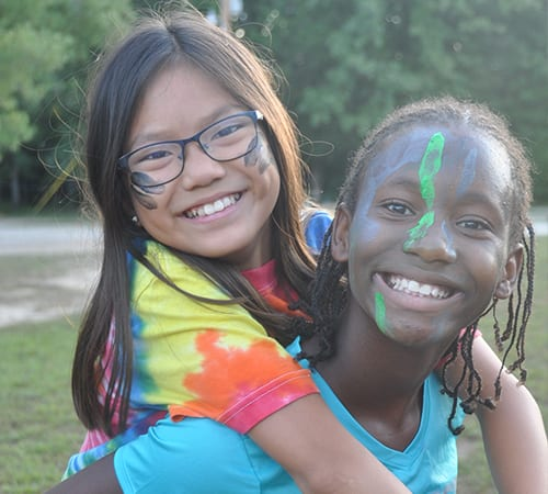 Daily Schedule - Happy campers piggy back ride - Cub Creek Science and Animal Camp