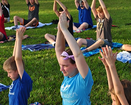 Early Birds & Night Owls - Campers doing morning yoga - Cub Creek Science and Animal Camp