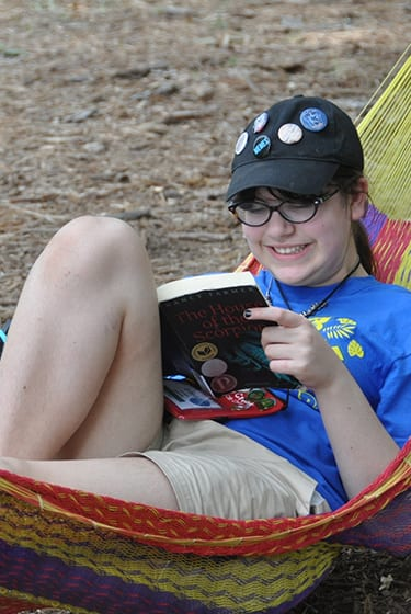 Even More At Camp - Camper reading in the hammocks - Cub Creek Science and Animal Camp