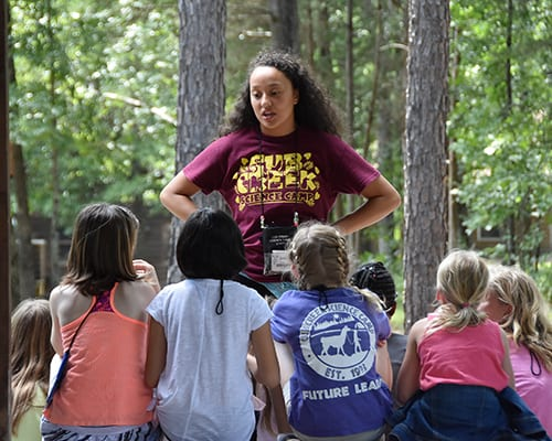 FAQ - Counselor explaining camp procedures - Cub Creek Science and Animal Camp