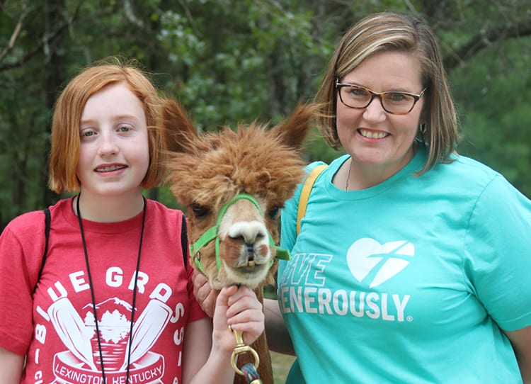 First Time Families - Camper family with Alpaca - Cub Creek Science and Animal Camp