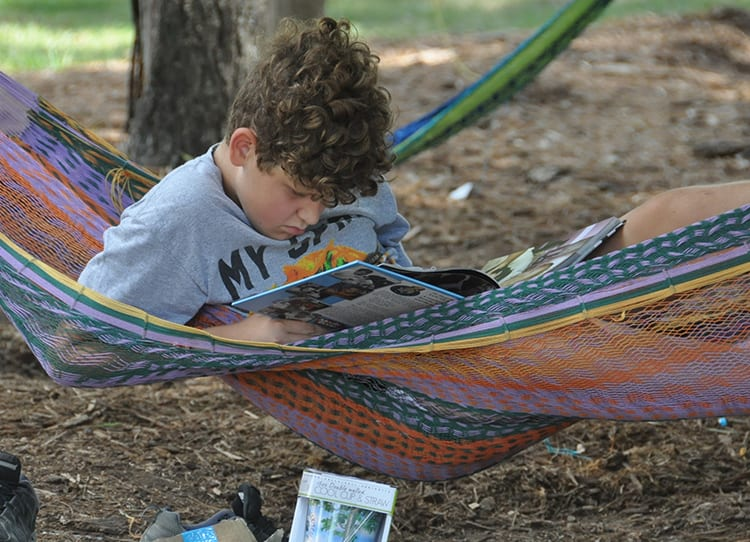 Free Time - Camper reading in the hammocks - Cub Creek Science and Animal Camp