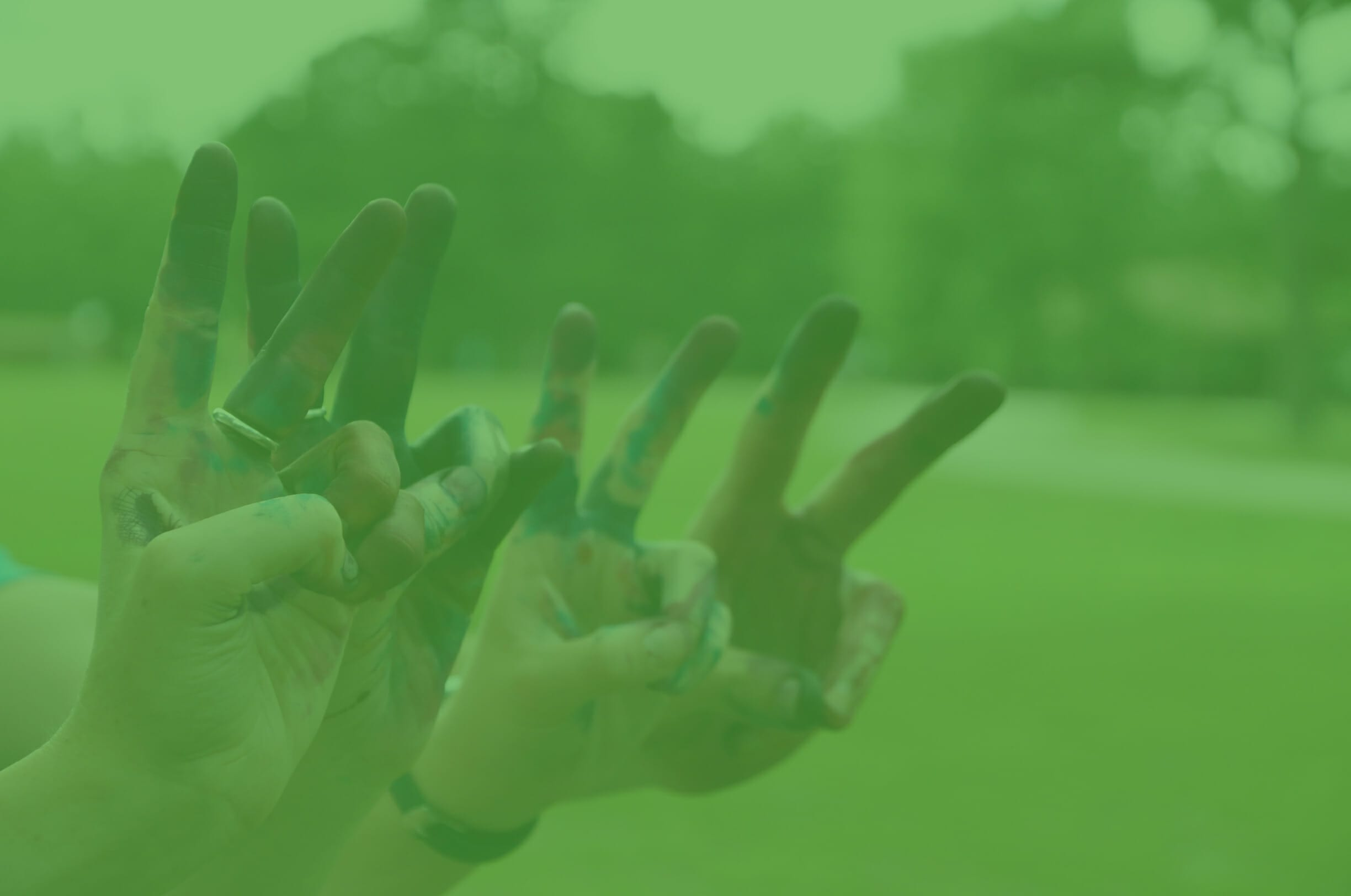 Home Page Testimonial Image - Happy camper hands giving peace sign - Cub Creek Science and Animal Camp