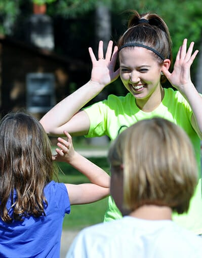 Join Our Team - Counselor playing games with campers - Cub Creek Science and Animal Camp