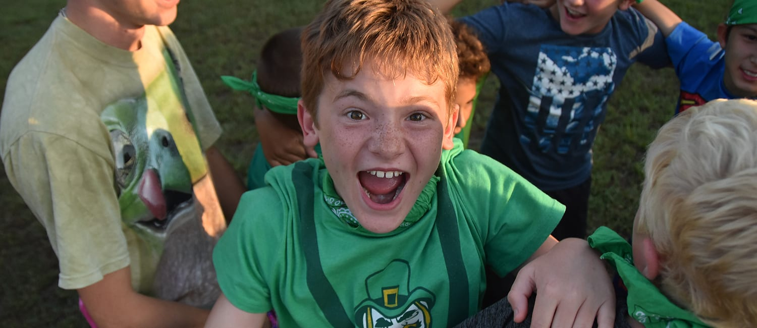 Paperwork And Payments - Excited camper during evening activity - Cub Creek Science and Animal Camp