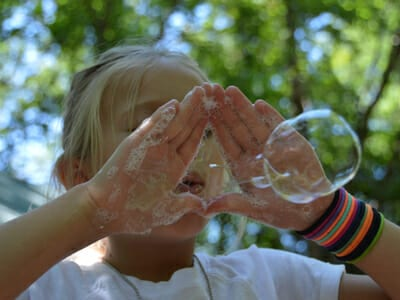 Camp Activities Photo Gallery Anchor - Girl blowing bubbles - Cub Creek Science and Animal Camp