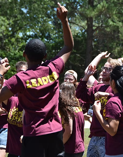 Thinking About Summer Camp - Staff cheering team spirit - Cub Creek Science and Animal Camp