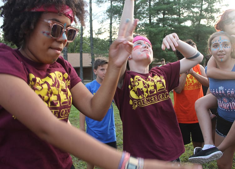 Thinking About Summer Camp - Counselors dancing with campers evening activity - Cub Creek Science and Animal Camp