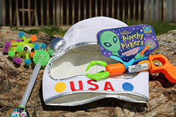 Astronauts & Aliens Care Package <br> Includes: Felt Space Hat, Alien Claw Toy, <br> Space Wand, Squishy Alien Toy - $15.00