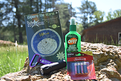 Camp Out Essentials Care Package <br> Includes: Star Finder, Bug Spray, Carabiner, <br> Flash Light, Batteries - $20.00
