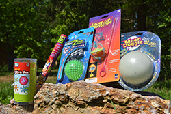 Lights Out Care Package <br> Includes: Light Up Jax, Glow Sticks, <br> Light Up Rebound Ball, Light Up <br> Gyroscope, Moon Glowing Ball - $19.00