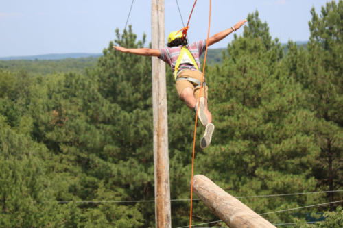 Camper Jumping on Leap Of Faith Tower - Cub Creek Science Camp
